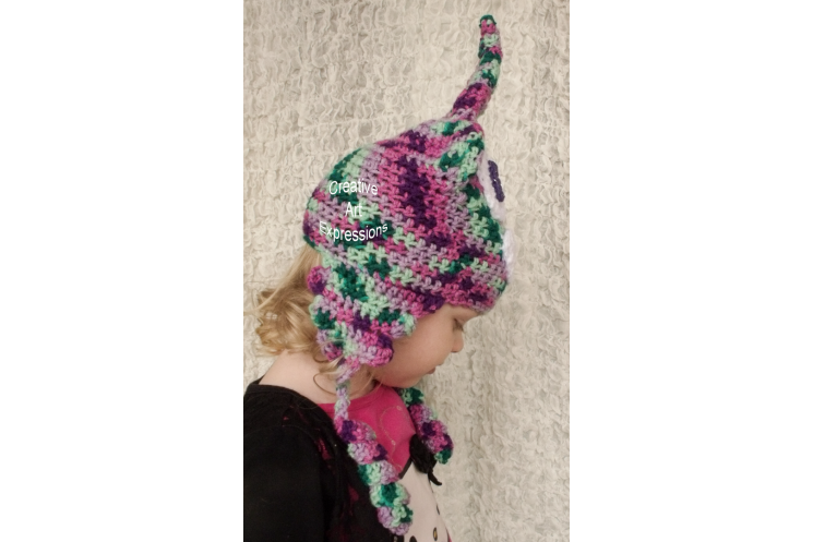 Side of Unicorn Poop Toddler Hat Crocheted Pink Green Purple Mint