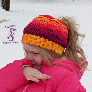 Crocheted Sunset Sea Messy Bun Sea Breeze Hat, Child Size 2T-5 years, Sea Breeze Collection, Mermaid Fashion, Unique Gifts, Handmade winter hat, Handmade Ponytail Hat, Mermaid at Heart, Ocean Crochet, Coastal Crochet, Crochet with Meaning